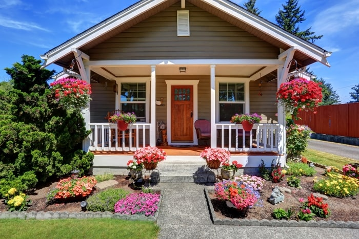 Small craftsman home with bright flowers and curb appeal.