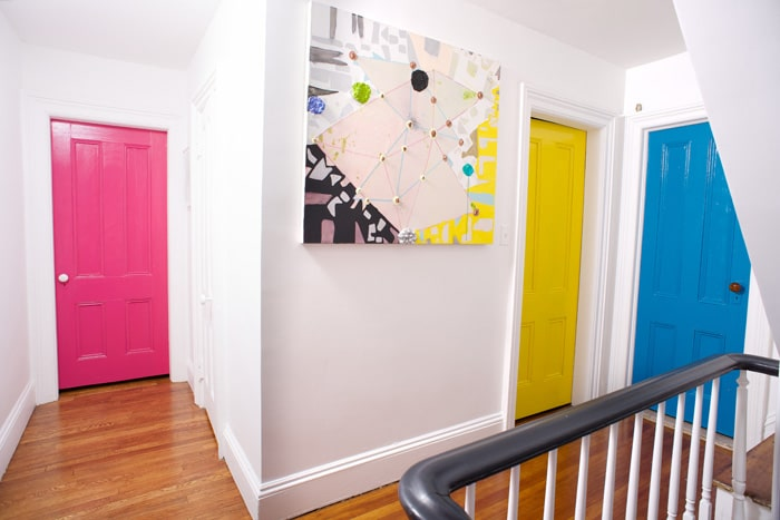 Pink, yellow and blue hallway doors.
