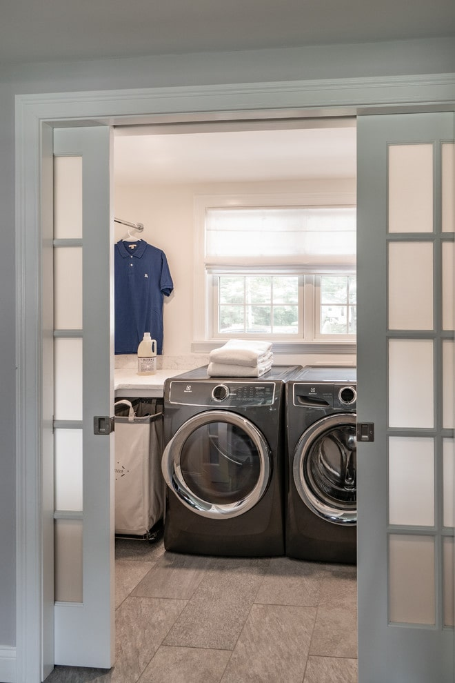 Laundry room with pocket doors.