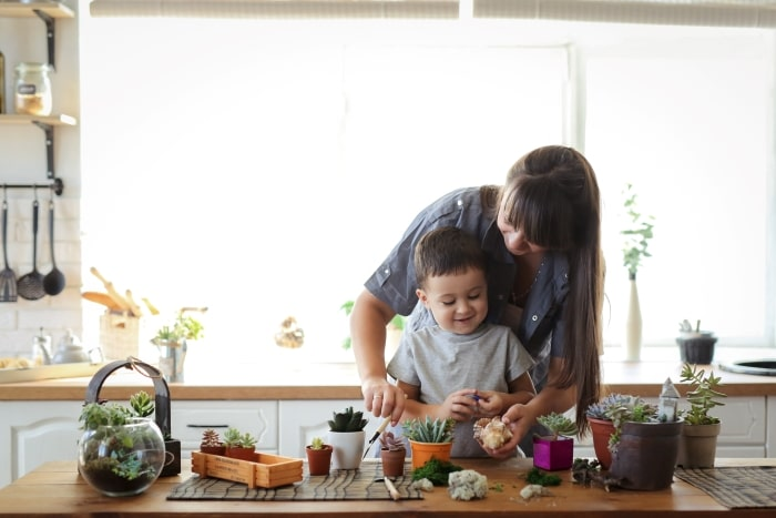 Mother and child building a terrarium.