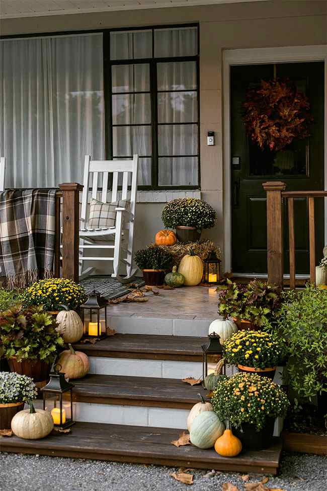 Fall front porch with blankets and pillows.