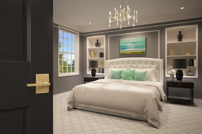 Glamorous master bedroom with satin brass Schlage Latitude lever.