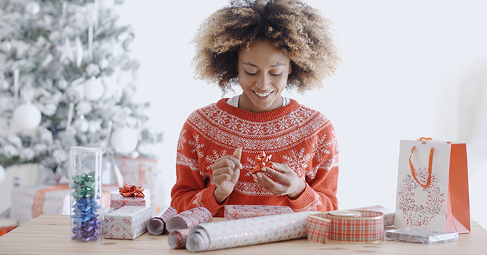 Woman wrapping Christmas presents.