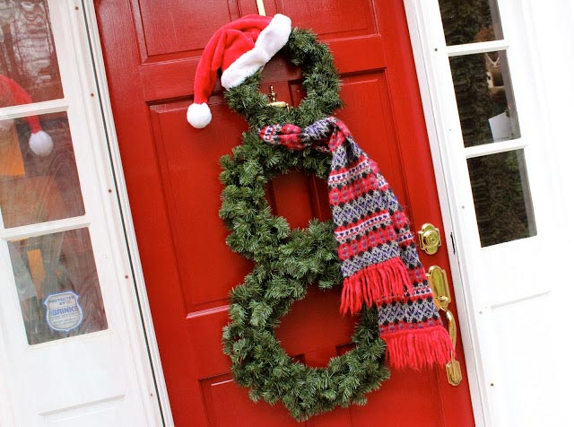 Three stacked wreaths to make a snowman on front door.