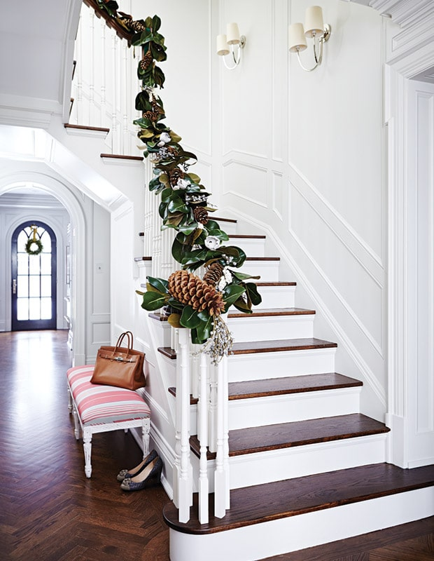 Entryway staircase with Magnolia leaf garland.