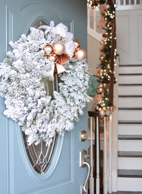 Frosted evergreen wreath with ornaments.