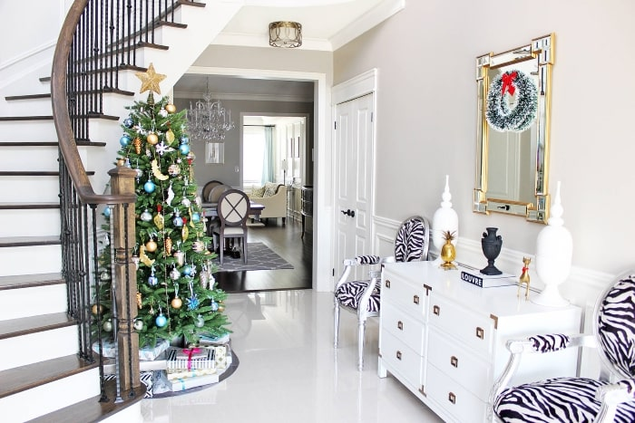 Glamorous entryway with colorful Christmas decor.