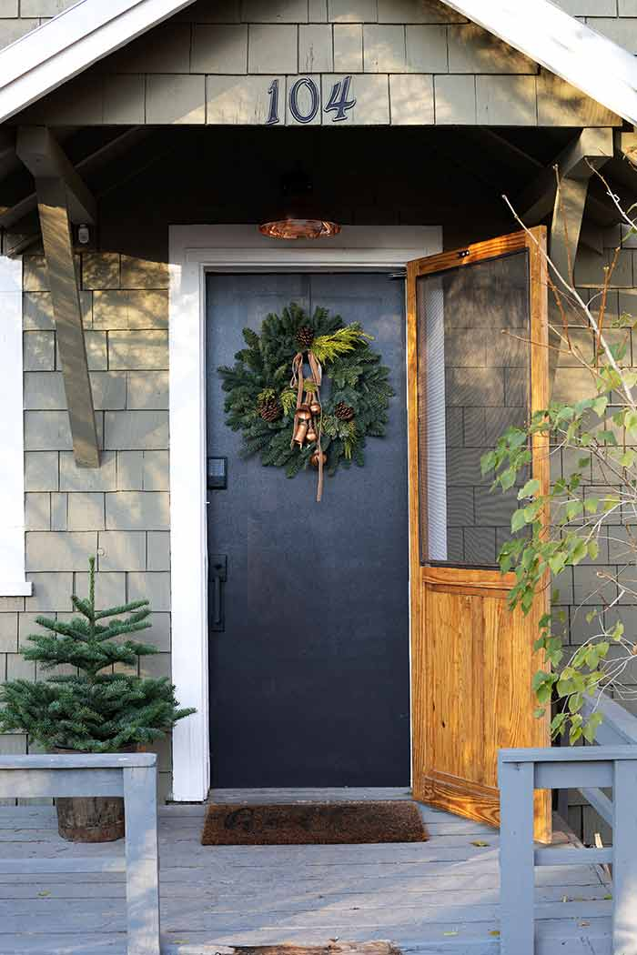 Black front door decorated for the holidays with Schlage Encode lock.