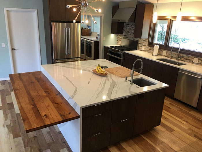 Kitchen island with lower countertop attached for accessibility.