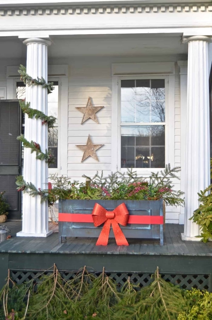 Ribbon wrapped planter on Christmas front porch