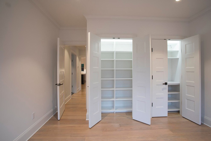 White closets with lights.