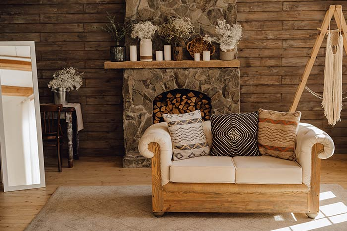 Cozy Bohemian rustic living room with stone fireplace.