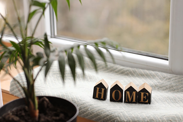 Cozy decor with wooden blocks spelling home.