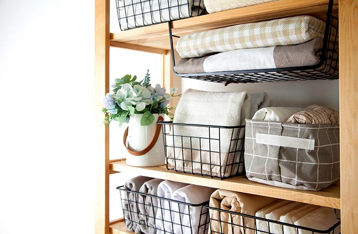 Storage rack with organized linens.