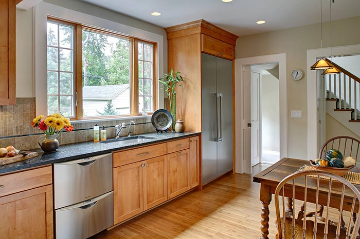 Energy efficient kitchen with bamboo flooring and energy star appliances.