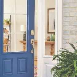 Schlage Encode smart wifi deadbolt in satin nickel with camelot trim on blue front door