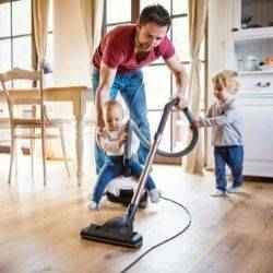 Dad vacuums kitchen with two toddlers | Schlage