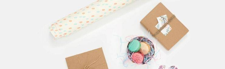 Gift wrap, gift boxes and a tin of macarons.