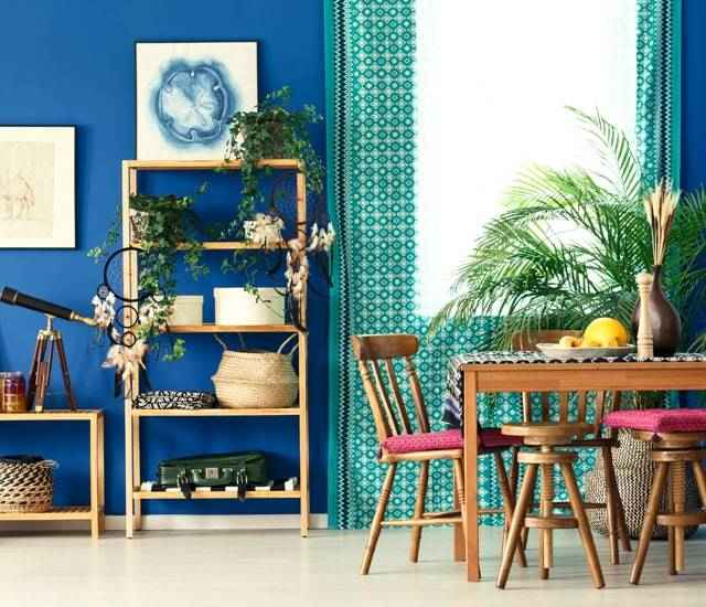 Bohemian modern dining room with bright colors.