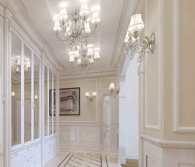 Hollywood Regency hallway with mirrors.