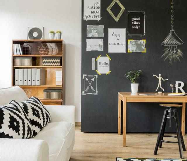 Living room with black chalkboard wall.