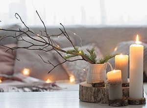 Minimalist holiday decor with candles and greenery.